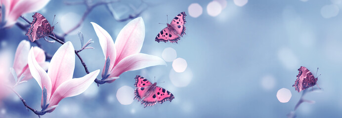Mysterious spring background with blooming pink magnolia flowers and flying butterfly. Fantasy floral banner Wall mural