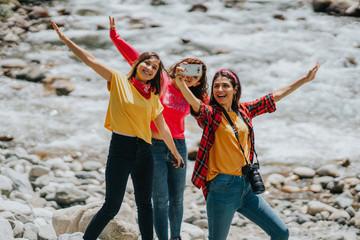 Group of friends taking selfie near the stream