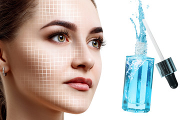 Beautiful face of young woman near blue cosmetic bottle.