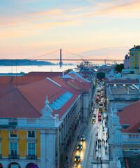 Fototapete - Lisbon Old Town street twilight