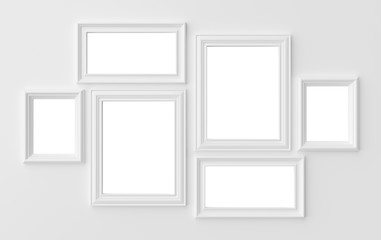 White photo frames on white wall with shadows