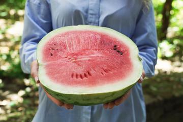 Summer Time. Fresh ripe half of watermelon in hand