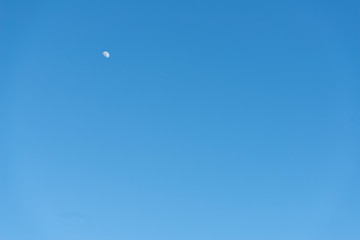 half moon during daylight with blue sky background, - image