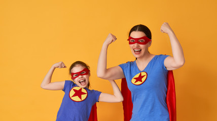 Family in Superhero costumes