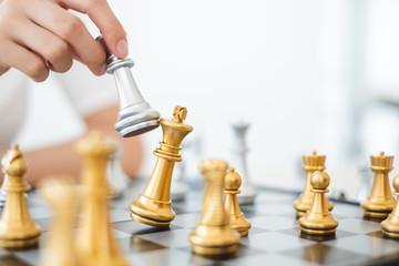 Chess game, gold and silver challenge match, planning and strategy concept