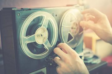 listening old records on vintage audio reel recorder