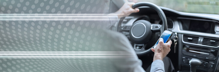 Man using a smartphone and driving. panoramic banner