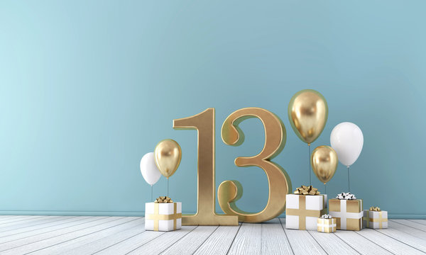 Number 13 party celebration room with gold and white balloons and gift boxes.