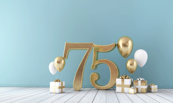Number 75 party celebration room with gold and white balloons and gift boxes.