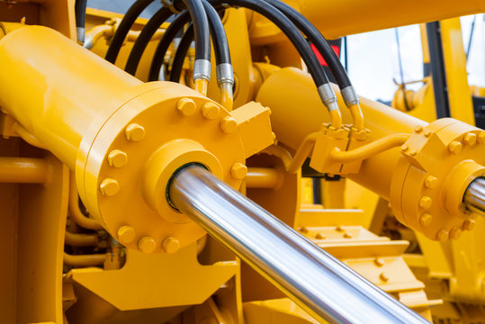 Powerful hydraulic cylinders. The main power and driving element for construction equipment