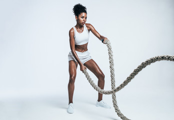 Athlete working out with battle ropes