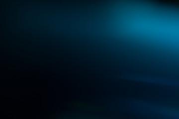 Lens flare effect. Soft defocused blurred light shine on dark blue background Wall mural