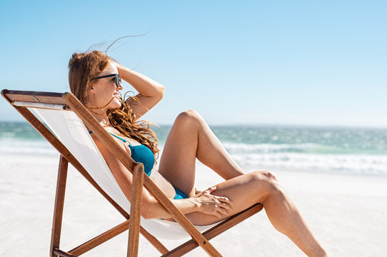 Relaxed woman sunbathing at beach