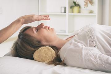 Professional Reiki healer doing reiki