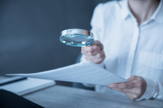 woman hand document with magnifier