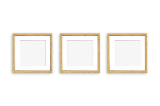 Three blank photo frames isolated on white wall,  realistic golden framework mockup