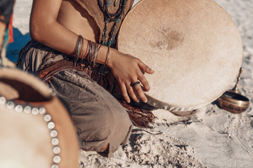 shaman drum in woman hand. playing ethnic music