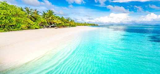 Fototapete - Beautiful Maldives island beach landscape. Luxury resort with chairs and umbrella for summer vacation and holiday background. Exotic tropical beach concept