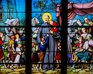 Saint Vincent de Paul on a Stained Glass in Paris