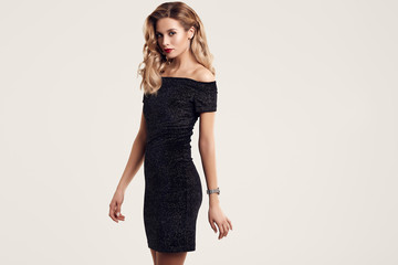 Gorgeous elegant sensual blonde woman wearing fashion black dress Wall mural