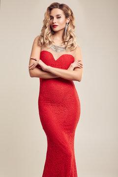 Gorgeous elegant blonde woman wearing fashion red dress