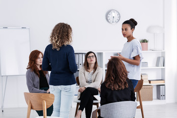 Group of young women talking sitting in a circle. Psychological support concept