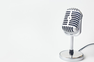 The vintage microphone close up image on white background..