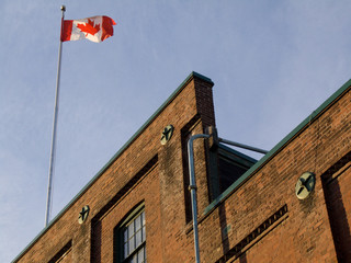 Canadian flag on rooftop of old building
