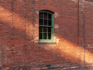 old window in red brick wall