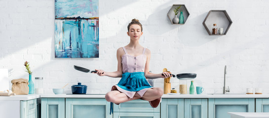 panoramic shot of young woman meditating in air with pans
