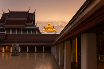Wall Mural - Wat Saket or Golden Mountain during sunset in Bangkok, Thailand.