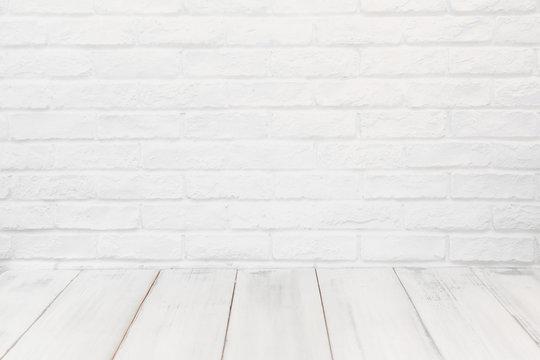 White wood table over white brick background