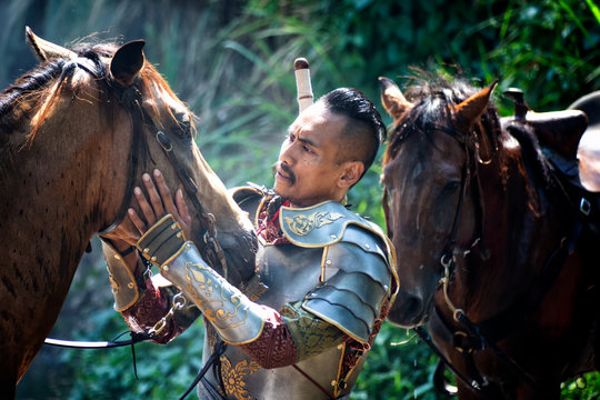 Aisan Thai soldier in the history scene with armor suit costume and horse