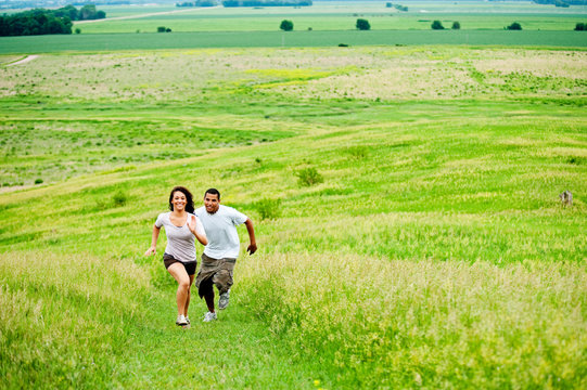 AJ Walker, 18 years old, Shanon Skillman, 18 years old, smiling as they run and horse around together on a grass trail winding it's way up Spirit Mound at the Spirit Mound Historic Prairie on Highway 19 in Southeast South Dakota on June 20, 2009. Through the cooperation of the Spirit Mound Trust, National park Service, SD Parks and Wildlife Foundation, and South Dakota Department of Game, Fish and Parks this 320 acres became part of the state park system in 2001.