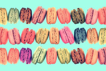Colorful rows macarons on vintage mint pastel  background