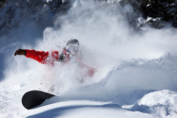 A snowboarder rips untracked powder turns in Vail, Colorado.