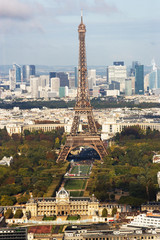High elevation view of Paris cityscape and the Eiffel Tower.