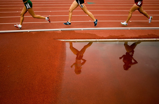 Runners' reflections in Track Relay in Southern California.