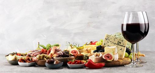 Italian antipasti wine snacks set. Cheese variety, Mediterranean olives, crudo, Prosciutto di...