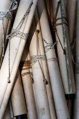 Close-up of scrolls fastened with twine.