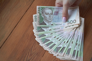 Ukrainian national currency, bills of different values, the calculation between people, the transfer of money.