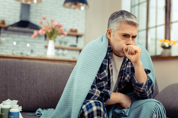 Pale sick mature man staying at home
