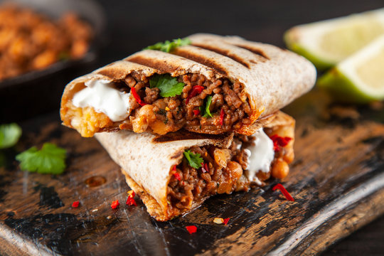 Mexican burrito with beef, beans and sour cream