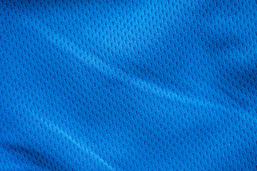 Blue fabric sport clothing football jersey with air mesh texture background