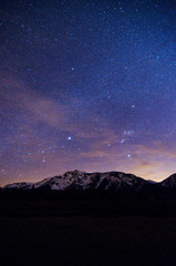 Milky way in the starry sky over Mount Tallac at night