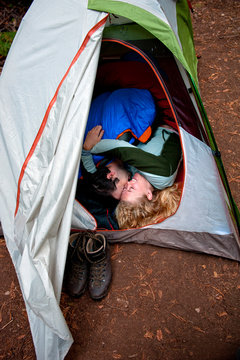 Couple cuddling in tent