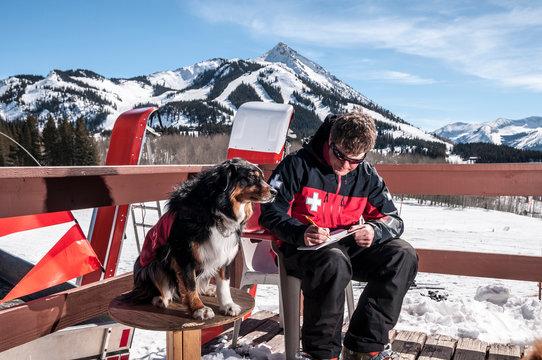 Male ski patroller working at the Crested Butte Ski Resort, Crested Butte, Colorado.
