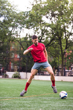 Athlete playing soccer on field