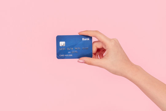 Crop girl with blue credit card