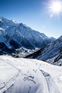 Aerial view of paragliders and mountains in winter, Chamonix, Haute-Savoie, France